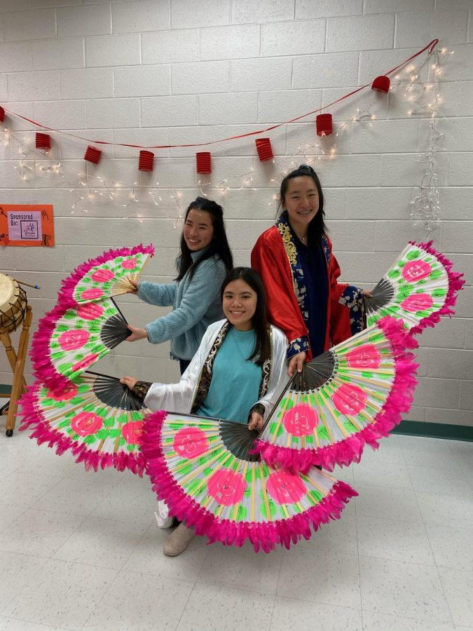 Students celebrating Lunar New Year at the school with food, games, and music. Everyone brought pieces of their own culture to share with others.