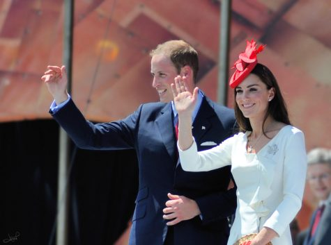 Prince William and Duchess Kate wave to a crowd in Canada.