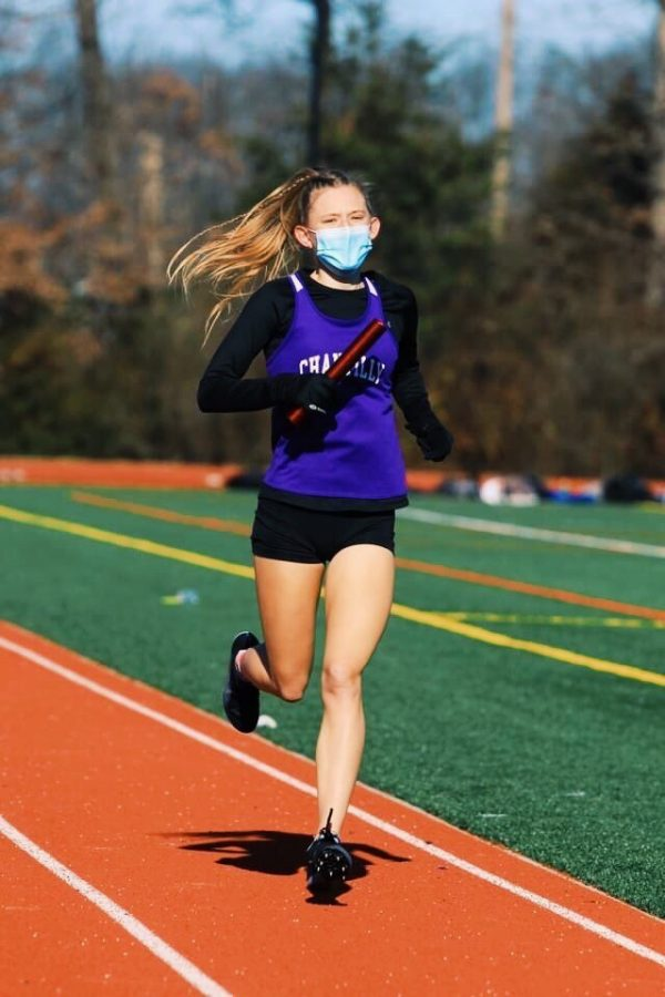 Junior Ava Miller runs in a district meet against Westfield and Madison in the previous winter track season.
