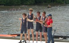 The Albemarle High School Scholastic Rowing Champions pose by the river.