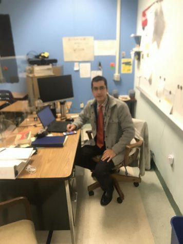 English teacher Eric Richardson works at his desk.