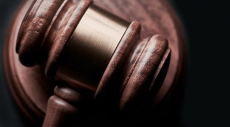 A gavel representing power and authority in the justice system.