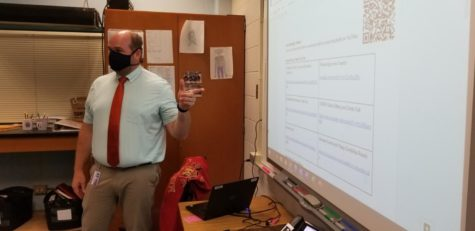 Science teacher Peter Bouwman instructs his students on Sept 20.