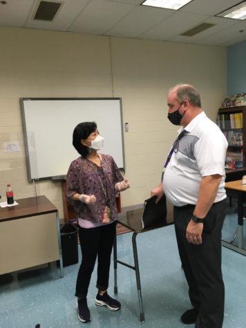Special education math teacher William Ruffle collaborates with special education teacher SuJin Han.