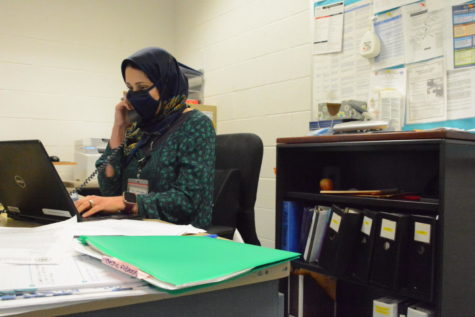 Nurse Aminian Ramissa catches up on some emails in the clinic on Sept. 22.