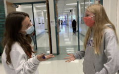 Senior Caelin Rowell gives advice to sophomore Lily Nyberg, as it is also her first year in the school building.